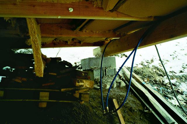fixation-cabane-perchee-ciment.jpg